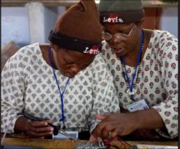 Women working on solar lighting circuit boards.